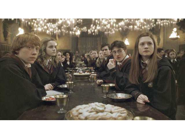 "Left to right, Rupert Grint as Ron Weasley, Emma Watson as Hermione Granger, Matthew Lewis as Neville Longbottom, Daniel Radcliffe as Harry Potter and Bonnie Wright as Ginny Weasley in Warner Bros. Pictures' fantasy adventure ""Harry Potter and the Half-Blood Prince."""