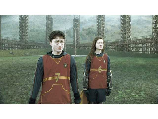 "Daniel Radcliffe as Harry Potter and Bonnie Wright as Ginney Weasley in a scene from ""Harry Potter and the Half-Blood Prince."""