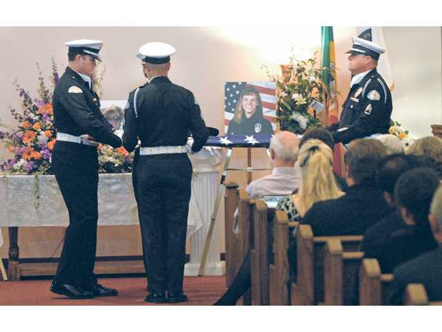The LAPD Honor Guard folds a flag for the family members of LAPD Detective Susan Clemmer at memorial services held at the Eternal Valley mortuary chapel on Thursday. Clemmer killed herself in the lobby of the Santa Clarita Valley Sheriff's Station on July 6.