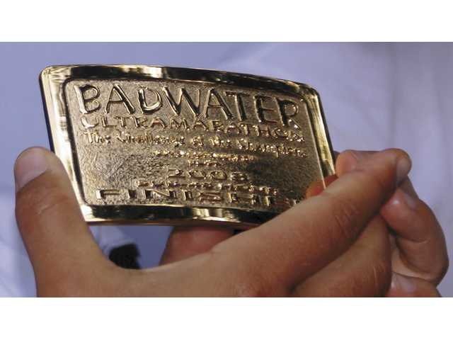 The coveted Badwater Ultramarathon belt buckle is only given to those who finish the 135-mile race in less than 48 hours.