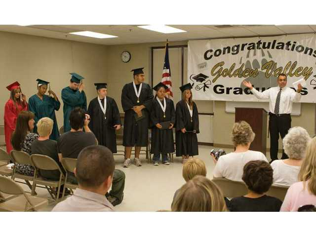 Golden Valley High School Principal Sal Frias congratulates seven students on their graduation achievement Friday morning at the high school.