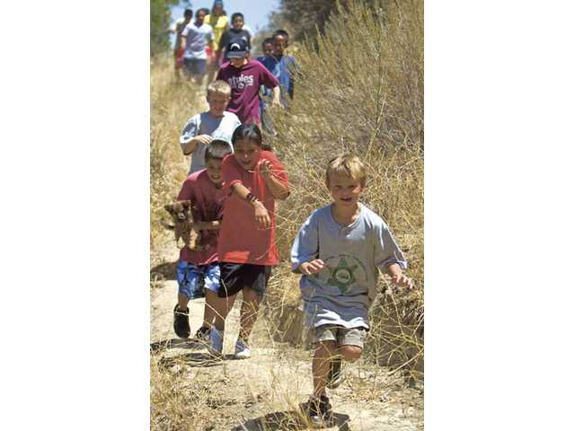 A group of kids returns from a hike in the hills behind Val Verde on Tuesday.