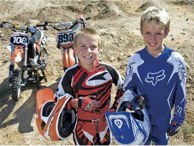 Robbie Wageman, left, a 10-year-old motocross rider from Newhall and 9-year-old Cody Eaton of Castaic, right, will compete at the 28th annual American Motorcyclist Association's Air Nautiques Amateur National Motocross Championships from Aug. 1-8 at Lrretta Lynn Ranch in Hurricane Mills, Tenn. Approximately 20,000 riders attempt to qualify for the event.