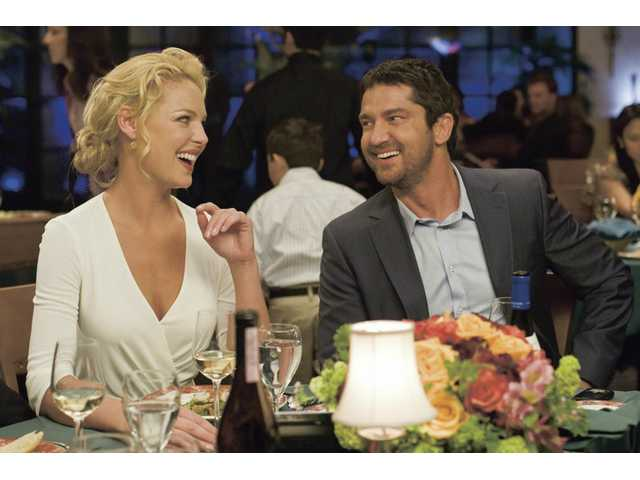 "Gerard Butler, right, and Katherine Heigl are shown in a scene from Columbia Pictures' ""The Ugly Truth."""