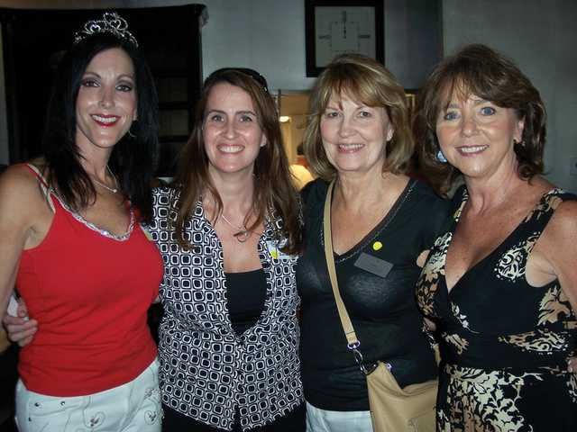 Shelley Hann, Kim Zimlinghaus, Marjanne Priest and Pam Ingram celebrate Hann's birthday at the SCV Chamber of Commerce mixer