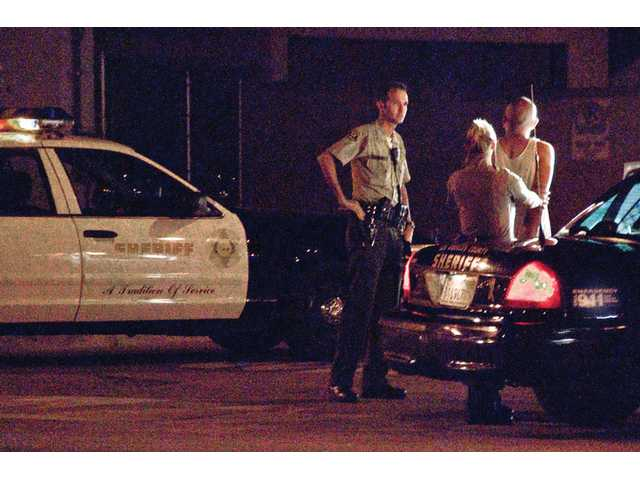 Sheriff's deputies detain a carjacking suspect at 14th Street and Railroad Avenue on Wednesday at 10 p.m.