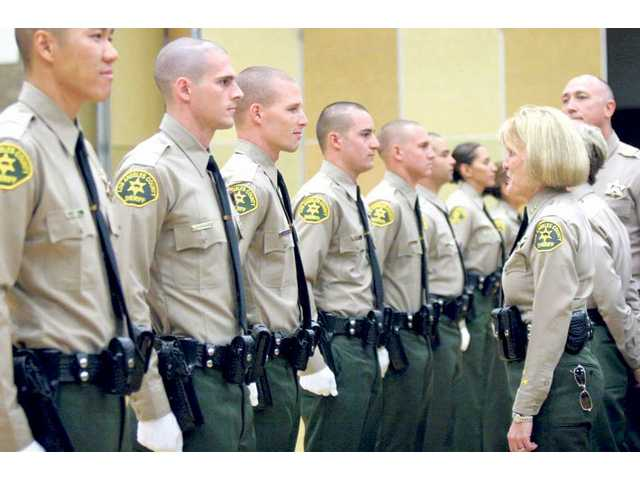 A group of 38 deputies, including three from the Santa Clarita Valley, are inspected one last time before they are sworn in as  the Los Angeles County Sheriff's Department on Thursday.