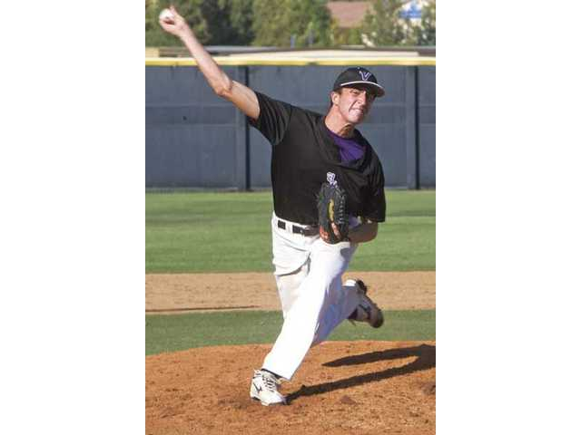 Valencia pitcher Justin Hanks throws against Simi Valley Thursday at Valencia High.