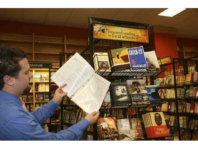 Scot Peeples, Borders sales manager, views a reading list for Santa Clarita Valley schools at a display in the Borders bookstore in Valencia.