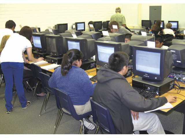 Placerita Junior High School students take advantage of a new computer classroom that was funded in cooperation with Golden Oak Adult School, to the advantage of both schools.