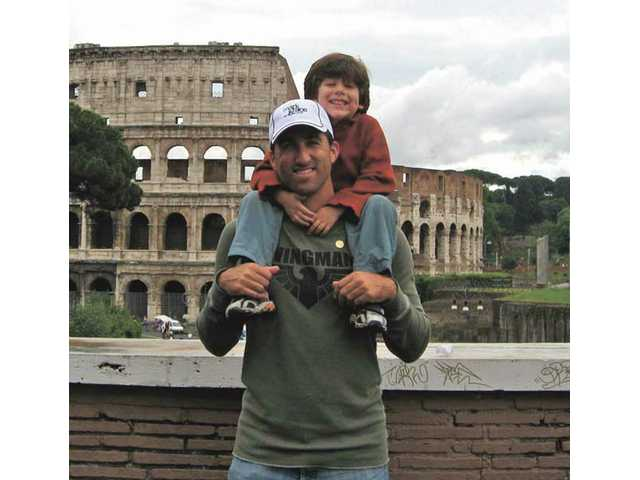 Andrew Lorraine stands with his son Mason in front of the Colosseum in Rome, Italy.
