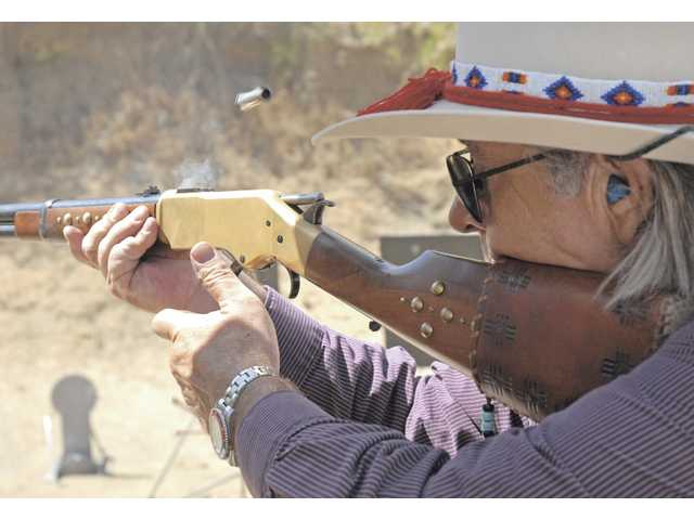 Daniel Nighteyes, also known as Glenn Rowe, fires his .45 caliber lever-action rifle.