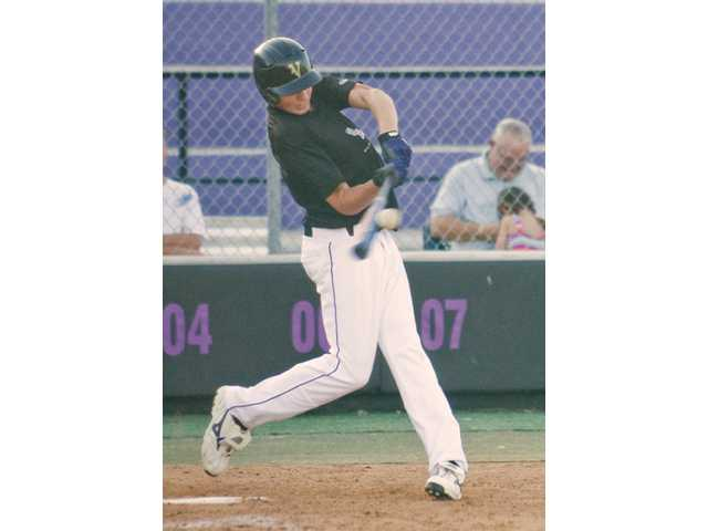 A Valencia hitter swings in the fifth inning.