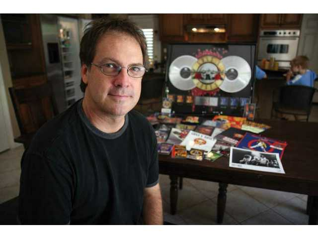 Craig Duswalt displays some of his Guns N' Roses memorabilia.