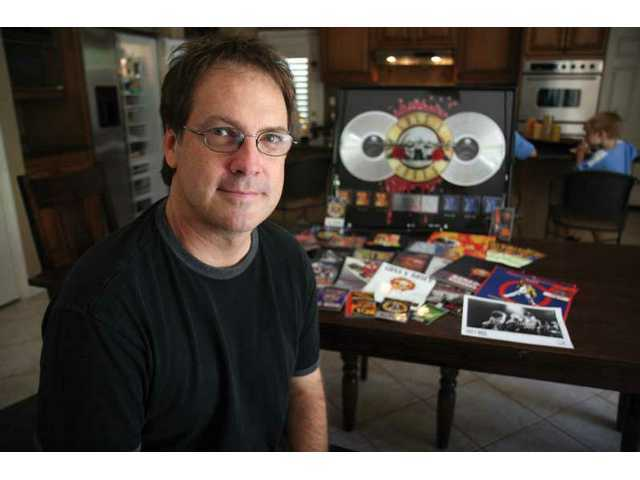 Craig Duswalt spreads out a few choice pieces of Guns 'N Roses memorabilia. He'll be on the judges panel on SCV Rock Star Night at the Santa Clarita Sports Complex Friday, Sept. 19.