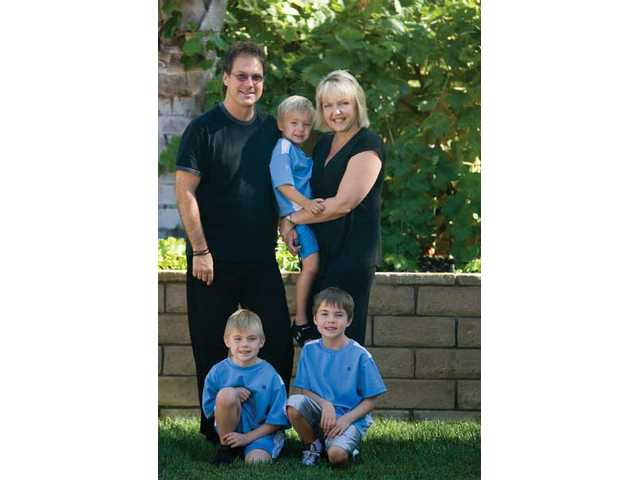 The Duswalt family from left to right, Craig Duswalt, Hayden, 4, Natasha, Ryan, 6, and Tyler, 8, in their Stevenson Ranch home.