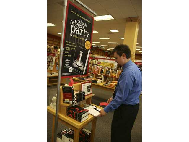 "Scot Peeples, Borders sales manager, checks out the reservation sheet for Stephenie Meyer's new book, ""Breaking Dawn"" which will be celebrated with a release party on Aug. 1 at Borders."