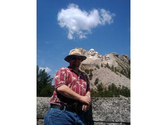 Robert Tilles visits Mount Rushmore in South Dakota during his trek across the United States with his family this summer. Tilles is a teacher at Hart High School.