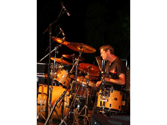 Jorgen Ingmar Aloss as Hollywood Larry (Mullen) drives the backbeat as Hollywood U2 rocks Central Park Saturday night.