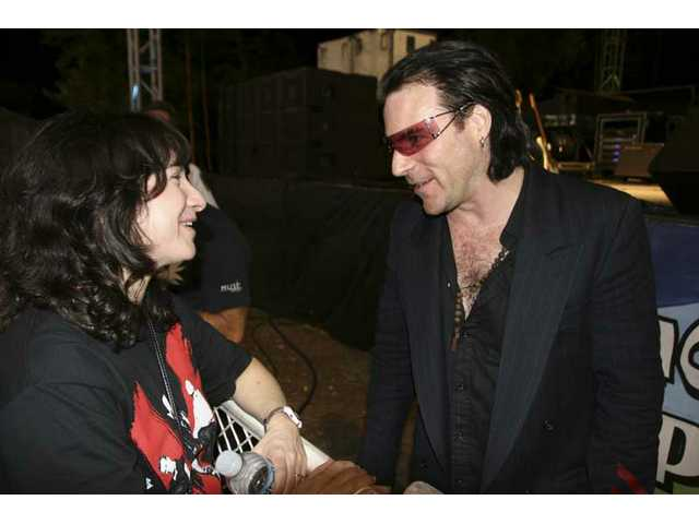 Lori Elkin of Saugus thanks Hollywood Bono (Joe Hier) after the band's Concerts in the Park set Saturday night in Saugus.