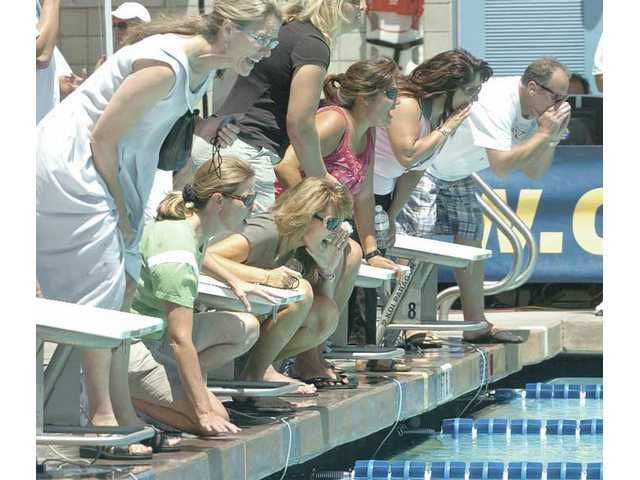 Parents cheer on the swimmers during the girls 800-meter event on Wednesday.