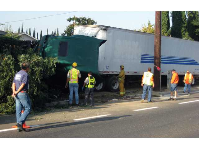 A big rig overturned and crashed into the wall of a residential lot on Bouquet Canyon Road and Camargo Drive in Saugus early Tuesday morning. The driver reportedly fell asleep on the wheel.
