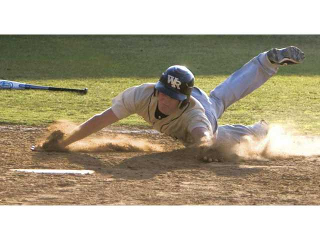 West Ranch's Aaron Smirnoff slides into home plate during the sixth inning Wednesday against Crespi at West Ranch High School. The Wildcats' VIBL team advanced to the varsity playoff finals by holding off Crespi 8-7.