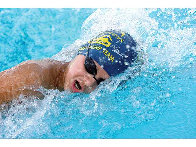 Local swimmers partcipate in the Junior Olympics held at the Santa Clarita Aquatic Center Wednesday. Jonathan Morsch swims for the Canyons Aquatic Club. The swim meet continues through Sunday.