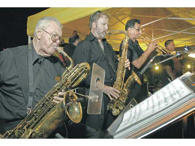 "Flattop Tom and His Jump Cats band members, from left, ""Big"" Bill Lucas, Dave Call and George Pandis, perform ""Don't Cheat the Feet"" at the Lexus of Valencia Jazz and Blues Concert held on Town Center Drive in Valencia on Friday night."