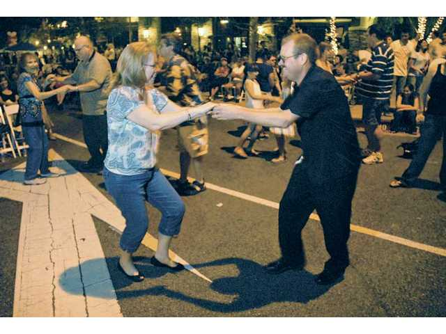 "Lori Lusby, left, and Rick Overby dance the East Coast Swing among other concert antendees. Doña Oxford, ""The Boogie Woogie Woman,"" will perform Friday night from 7 p.m. to 9:30 p.m. Admission is free."