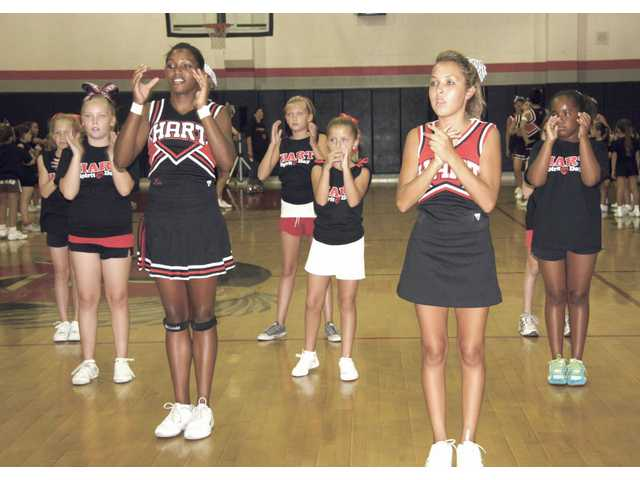 Hart High School cheerleaders conduct a cheer exercise during last year's Spirit Day activities.