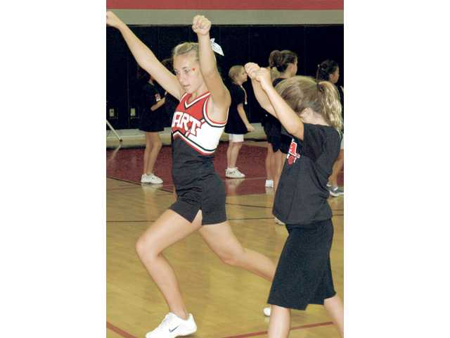 Hart High School junior varsity cheerleader Kelsie Leach, left, leads a cheer drill for the 2008 Spirit Day at Hart High School.