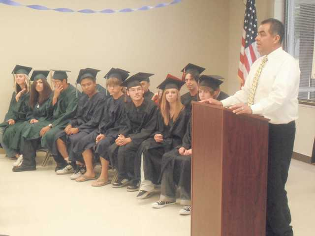 Golden Valley High School Principal Sal Frias addresses the graduates during the ceremony.