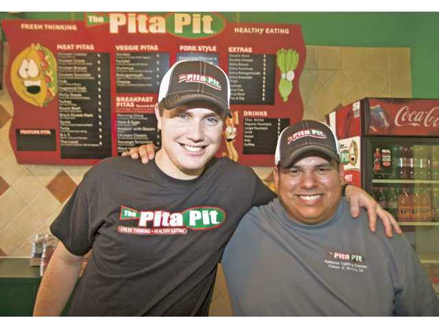 Childhood friends Nathaniel Victor, 26, left, and Chris Salazar, 26, have teamed up to re-open the Pita Pit at the Gateway Village shopping center in Valencia. The grand opening was Monday.