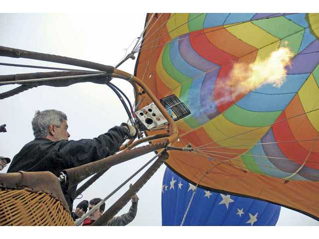 Pilot Kurt Adelsberger fills his balloon with hot air.