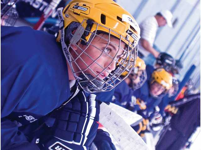 Jordan Spesak, 14, looks on at the hockey camp at Valencia Ice Station. The camp, which continues through the end of the week, is led by Anaheim Ducks players Matthieu Schneider and Ryan Getzlaf.