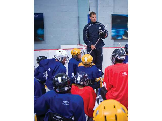 Ryan Getzlaf, a member of the Anaheim Ducks, talks to the first-ever hockey camp at the Valencia Ice Station on Monday. The camp, which continues until the end of the week, will include lessons from other members of the Ducks and the Valencia Flyers hockey team.