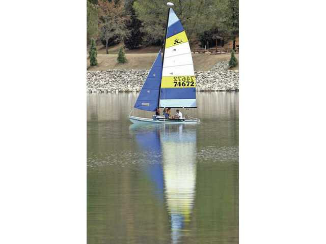 A sailboat is reflected on Castaic's lower lake on Monday afternoon.