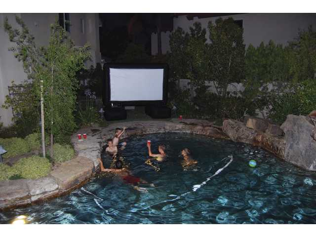 "Noah Abramson and friends enjoy a backyard movie party during to celebrate his 10th birthday recently at his family's residence in Stevenson Ranch. They watched ""National Secret: Book of Secrets"" on an outdoor movie system rented from Outdoor Movie Events."