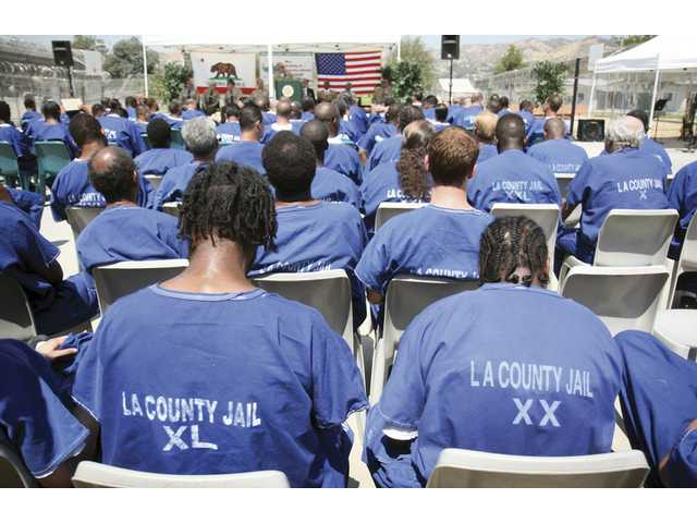 A group of inmates from the Pitchess Detention Center during a MERIT graduation ceremony in July. In October, volunteers from Grace Baptist Church will host a Returning Hearts Celebration event at the Castaic center, allowing the male inmates to spend a day with their kids.