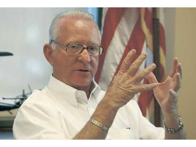 "Congressman Howard P. ""Buck"" McKeon describes his trip to Afghanistan at a news conference Tuesday in his Santa Clarita Valley office."