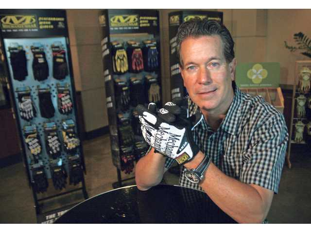 Mechanix Wear President Nick Hale wears a pair of the gloves similar to the ones he recently donated to the men and women serving on the USS Reagan.