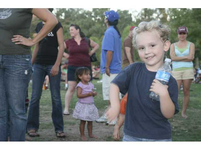 Two-year-old Gavin of Santa Clarita displays his one-handed air-guitar technique at The Craze's concert at Central Park Saturday night.