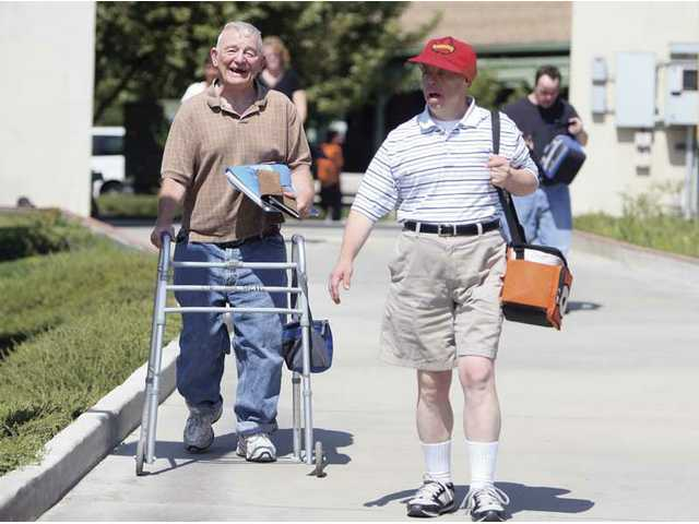 Residents of the Los Angeles Retarded Citizens' Ranch in Saugus return to their villas to prepare to go bowling Tuesday afternoon. State budget cuts amount to a loss of about $100,000 a year, roughly 3 percent of the ranch's budget. Numerous programs will be eliminated at the ranch due to these cuts.