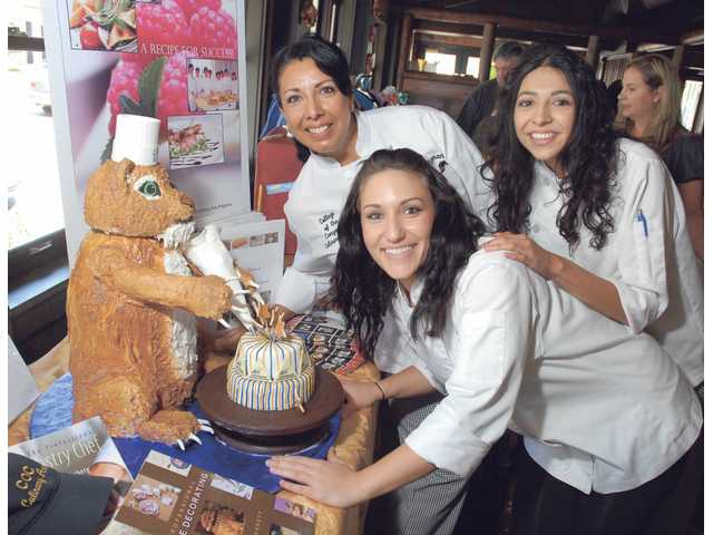 College of the Canyons culinary arts students (from left) Ana Guzman, Meray Arbid and Ingrid Ferris pose with their winning entry.