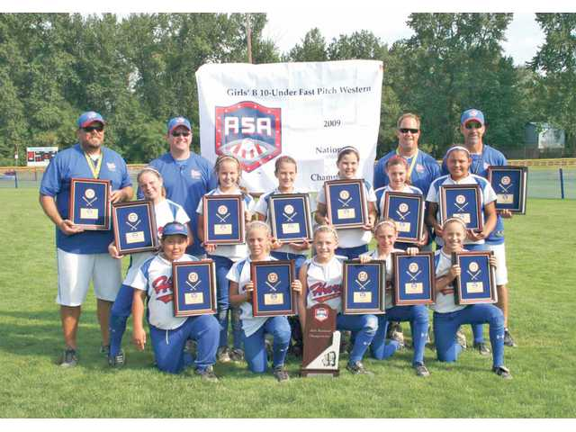 The Hart Gold U-10 softball team won the 2009 ASA U-10 National Championship in Salem, Ore., earlier this month. Team members are, front row, from left: Ty Cueva, Cassidy FitzGerald, Amanda Doyle, Cayla Kessinger and Abby Sweet. Middle row: Lindsay Clare, Jessie Harper, Raquel Blanchard, Brittney Ross-Smith, Emily Anderson and Mariah Lopez. Back row: Manager Darren FitzGerald, coach Jud Doyle, coach Cory Kessinger and coach Geoff Ross-Smith. Not pictured: Sierra Boyajian.