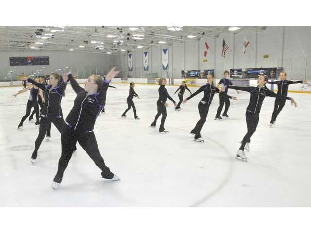 Members of the Los Angeles Ice Theater group perform to the music of the Forrest Gump Suite on the ice at Ice Station Valencia.