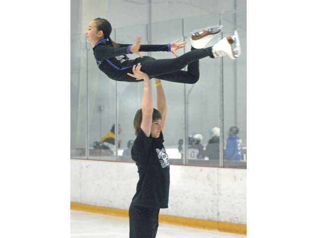 Darian Weiss, 16, and Rachel Trail, 13, perform a swan lift. The group includes skaters from throughout Southern California, including many from the SCV.