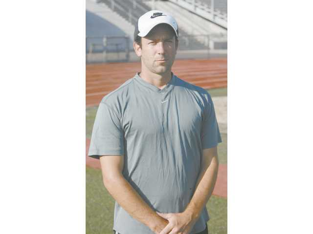 Eric White, a 1999 Canyon High grad, has come back to coach girls soccer at his alma mater.