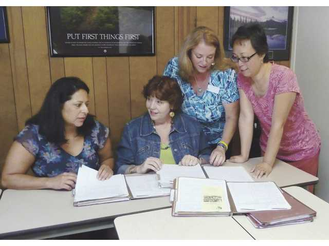 From left, care manager Michelle Cornell, Supportive Services director SuzAnn Nelsen, and care managers Candye Rucker and Karin Kelly discuss cases in an effort to keep seniors safe in their own homes for as long as possible through providing resources and available assistance.
